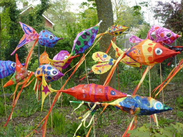 A colourful shoal of fish carnival decorations.