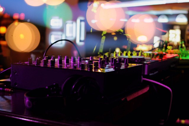image of mixing board under colourful nights.