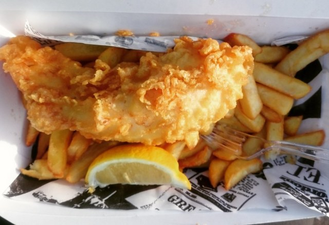 picture of fish and chips with a slice of lemon.