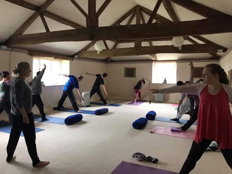 young people doing yoga.