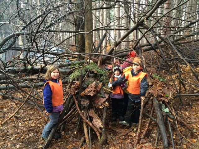 image of children building a den in the forest.