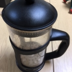 A glass and black cafetière